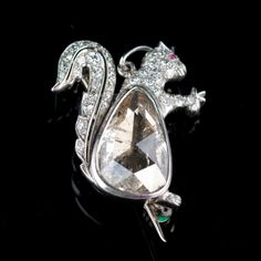Art Deco DIAMOND SQUIRREL BROOCH Country:	  	France Period:	  	1900-1930  Platinum  brooch/pendant in the shape of a squirrel is set with a large pear shaped rose cut diamond, small brilliant cut diamonds and a ruby set eye.   D