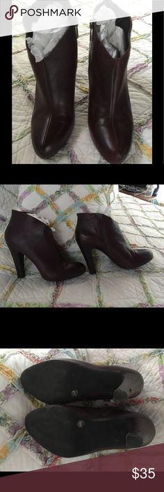 Jessica Simpson high heeled ankle boots Mahogany brown color Jessica Simpson high heeled ankle boots. These are gorgeous leather and very comfortable for high heels. I only wore these twice, but my legs are so short I couldn't pick them up high enough to keep the back of the heel from getting scuffed. I'm sure this is an easy remedy for shoe repairman but with my illness I rarely get out, so I wouldn't wear anymore either. Like new except for scuff on heel as pictures.bought two pair on sale…