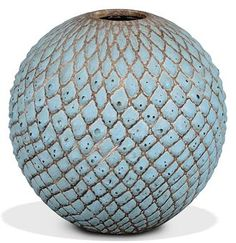 A JEAN BESNARD GLAZED-CERAMIC VASE  CIRCA 1940  With raised, textured turquoise glaze  7¼ in. (18.5 cm.) high  Incised JB