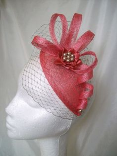 Coral Watermelon Pink Beatrice Teardrop by IndigoDaisyWeddings, £35.50 Order Now from www.indigodaisyweddings.co.uk Specialising in stunning bespoke cocktail fascinators and formal hats in a wide range of colours, perfect for Royal Ascot and The Kentucky Derby. Plus all your wedding floral accessories including shoe clips, vintage flapper bands, feather and flower fascinators, feather fans, fairy wands, wrist corsages, wedding bouquets & buttonholes. Worldwide Delivery.