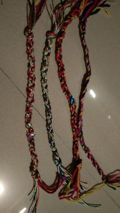 Handmade rakhees; prepared out of threads of wool and silken crochet. ₹ 30 each.