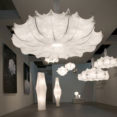 "lighting by flos -- gorgeous resin ""fabric"" diffuser over steel frame chandeliers"