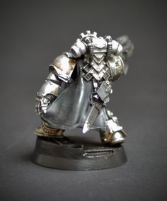 Knight Errant recruted from the Iron Hands Legion. Conversion based on the Forge World Garro model.