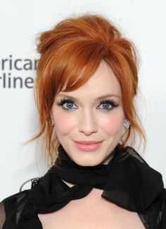 Christina Hendricks Beehive - Christina Hendricks channeled Brigitte Bardot with this messy-sexy beehive during the Elton John AIDS Foundation Oscar viewing party.