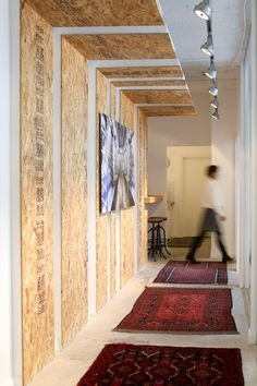 Creative office design -  S2R offices at Tel-Aviv, Israel.  O.S.B boards for hanging artwork in the corridor.