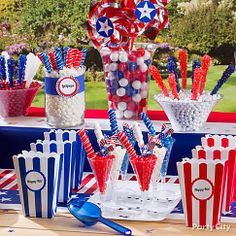 Salute to sweets! Set up a stars-and-stripes candy buffet at your BBQ with patriotic-hued candy inside clear containers!