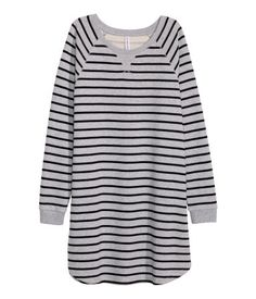 Short dress in sweatshirt fabric with long raglan sleeves, ribbed cuffs and a rounded hem.