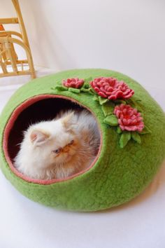Cat house/Cat bed/Cat cave/Cat vessel with flower decorations. $80.00, via Etsy.