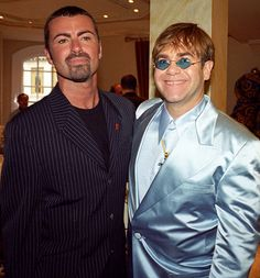 George Michael and Elton John at the Gianni Versace 'Men Without Ties' launch party in London, 14th June 1995.