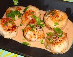 Photo of pan-seared sea scallops with creamy garlic sauce