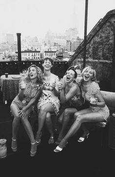 sex and the city girls on a rooftop in New York City in black and white