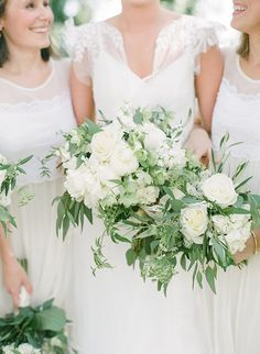 White bouquets on white bridesmaid dresses | Rach Loves Troy http://southernweddings.com/2016/09/13/coosaw-point-river-club-wedding-rach-loves-troy/