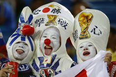 Fans of Japan pose before the start of the 2014 World Cup Group C soccer match at the Dunas arena in Natal June 19, 2014.