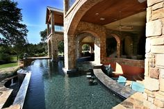 Ridgetop Terrace on Lake Travis Pool with Swim Up Bar by Zbranek & Holt Custom Homes, Lake Travis and Austin Luxury Custom Home Builder #austinluxuryhomemagazine