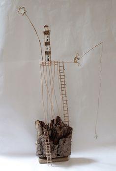 Bellissimo sito con scene realizzate in fil di ferro e carta