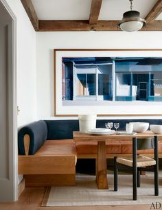 Example of built-in banquette. An Axel Einar Hjorth dining table with a Charlotte Perriand chair and custom banquette create a kitchen breakfast nook. Photo-graph by Wim Wenders. Banquette Seating In Kitchen, Kitchen Benches, Dining Nook, Dining Room Design, Kitchen Decor, Built In Dining Room Seating, Kitchen Nook, Kitchen Layout, Kitchen Ideas