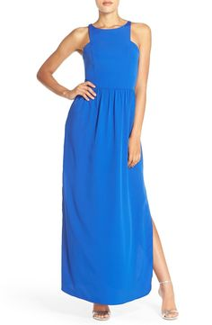 Clean lines, cutaway shoulders and high side slits put a contemporary spin on this flowy maxi dress in a bright and bold blue.