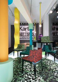 Kartell presents new Ettore Sottsass collection in Memphis-themed exhibition.