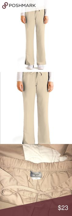 """Grey's Anatomy Drawstring Scrub Pants Khaki SMALL Junior Fit 5 Pocket Drawstring Scrub hospital pant. Worn once, excellent condition. Size small petite. Size tag missing. See order history from Amazon. Tag was removed. Style 4232P (petite) Moderate flare leg pant with low rise, ankle slits, & drawstring front closure & back elastic.  5 pockets including 2 at hip, 2 back, and 1 hidden cellphone/change.  Waist across: 15"""" Hips across: 20"""" Inseam: 29"""" Material: 77% Polyester, 23% Rayon  Feel…"""