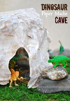 Paper Mache Dinosaur Cave and Tunnels by Crayon Box Chronicles.  Easy to set-up dinosaur diorama explores small world play with paper mache crafts and sensory materials.