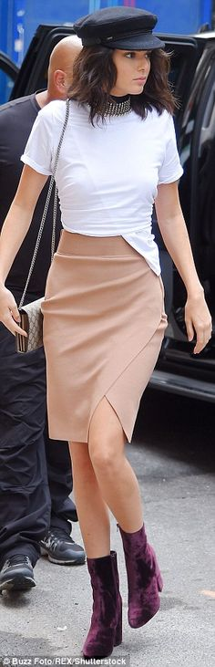 Off the runway: The 20-year-old reality maven looked effortlessly stylish in a white T-shirt and beige wrap skirt