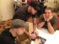 Steve and Tango (Ghost Hunters) signing autographs for Josh (Destination Truth)