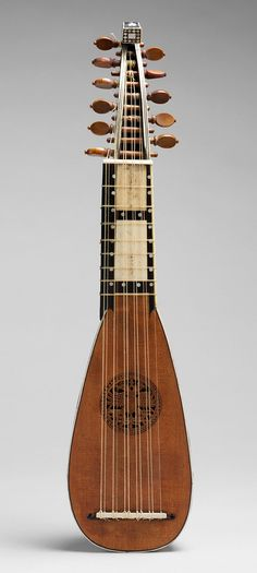 Mandolino. Date: ca. 1710. Geography: Italy. Culture: Italian. Medium: Spruce, ebony, ivory, mother-of-pearl. Dimensions: 21 1/16 × 5 × 2 11/16 in. (53.5 × 12.8 ... www.metmuseum.org/toah/works-of-art/2008.2a,b/