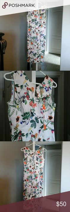 Floral bird T-length dress Brand new. Awesome printed fabric with floral and tropical birds, bought for a bridesmaid dress and didn't fit me.  65% polyester 32% cotton. Has a very sheen satin feel. Key hole on the front, zipper on the back. Length us mid calf..very retro feel! My loss is your gain! Dresses Midi