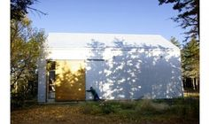 sliding barn doors over garage doors by Canadian architects Yiacouvakis Hamelin