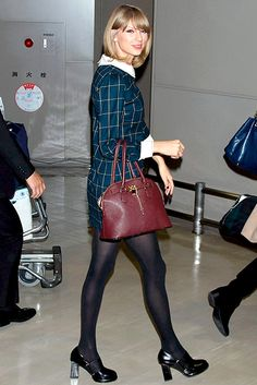 Taylor Swift's vintage-inspired frock features a plaid design and a classic Peter Pan collar.