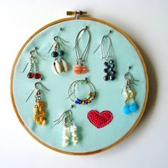 berrysprite: Earring holder tutorial- I have made this but without the pins and got so frustrated at the earrings falling out. The pins are a brilliant plan!