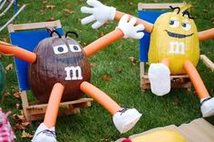 Cute! M&M pumpkins..looks to be spray painted pool noodle( can be bought for <1$ Aftr summer sale) for arms n legs... a must try for nxt yr!