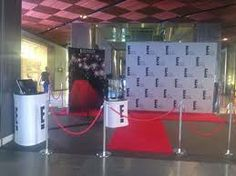 Red carpet with scattered cocktail tables