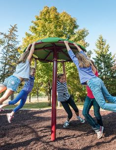 This multi-user Flywheel™ Spinner invites kids to hang on and play together, providing social interaction, along with vestibular stimulation.   #play #fun #kids #healthy