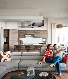 Actor Bryan Cranston and his wife rescued a decaying piece of military housing and gave it a modern makeover, throwing splashes of warm color onto neutral canvas of plush furniture for a beach house as snug as it is sleek. Photo byArt Streiber.
