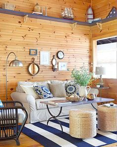 Small nautical living room idea with pine walls and blue and white decor.
