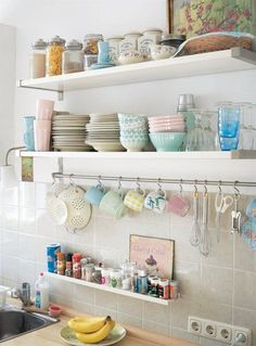 Oorganizing: open shelving for dishes. Tiny shelf for spices. Rod and hooks for hang mugs, utensils