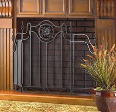 """by Accent Plus Evocative of the ironwork of traditional Italian artisans, this curvaceous folding fireplace screen features exquisite black cast iron accents.  Center panel is 22 1/8"""" x 30 5/8"""" high; each side panel is 10 3/8"""" x 25"""" high.  allgooddecor.com  #allgooddecor #decor #candles #accents #figurines #furniture #gifts #decorations #lighting #mirrors #fountains #outdoor #toys"""