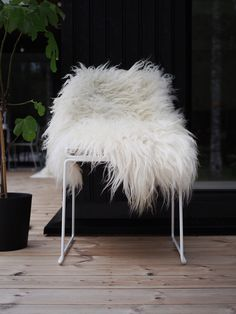 An Icelandic sheepskin will nicely cover any chair and create a cozy look.  For handmade and eco friendly products visit: www.naturalbazaar.eu