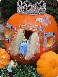 Use some of your kids favorite toys, and make a pumpkin they'll never forget. By using Cinderella toys, and craft items like rhinestones, a crown, and tulle, this pumpkin brings the fairy tale to your own backyard.