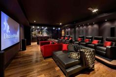 home theater room | Home theater room with animal print seats and a large bar.