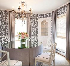 The dining room is so pretty – wallpapered in the same reverse toile with a skirted table.  Love the painted chairs with the gray trim added to the white.   The shades are high quality, and it shows.  Pretty light fixture.  Just a great, well designed room – love it!  From Chandros web site.