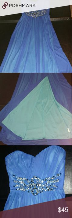 Blue Floor Length Gown with Slit Skirts Gorgeous blue strapless gown. Floor length flowing skirt are slit off center for showing some leg! Bejeweling under the bust. Worn only once for a pageant and kept in excellent condition. Dresses Prom