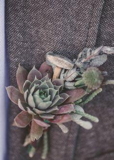 mixed succulent boutonniere // photo by Tyler Rye Photography // http://ruffledblog.com/blacksmith-inspired-wedding-ideas