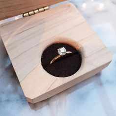Custom engagement ring by @christinakober inside a beautiful custom made wooden box by @kolkdesignbuildco.