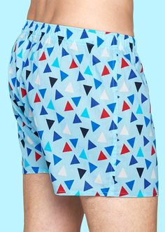 Red, white and blue triangles cover the landscape of these light blue boxers for men. The vivid coloring and bold patterns make these 100 percent cotton boxers a stylish addition to any man's wardrobe. An elastic waistband keeps them in place while open-fly construction provides comfort and convenience. Offered in sizes small through extra-large.