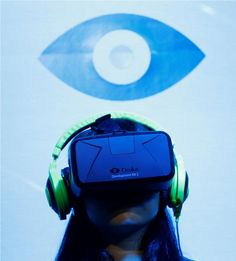 A woman tries out out Oculus VR's headset Oculus rift development kit 2 at its booth in Tokyo Game Show.
