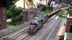 we don't have real Trains but Scale Model Train Scenery like Model Trees, Model Lamps, Model Cars and Model Figures for Model Trains