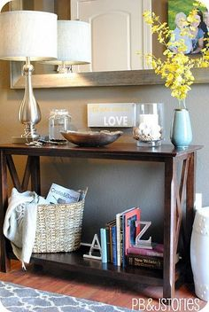 Entryway table: cool lamp, small dish to hold keys/change, small file holder (napkin holder) for mail, and a candle....maybe build in cubbies/baskets underneath for shoes?