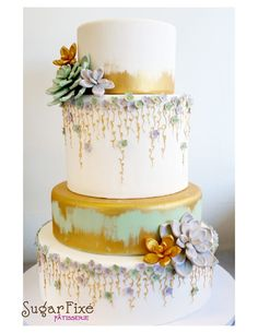 Gold succulents and vines cake